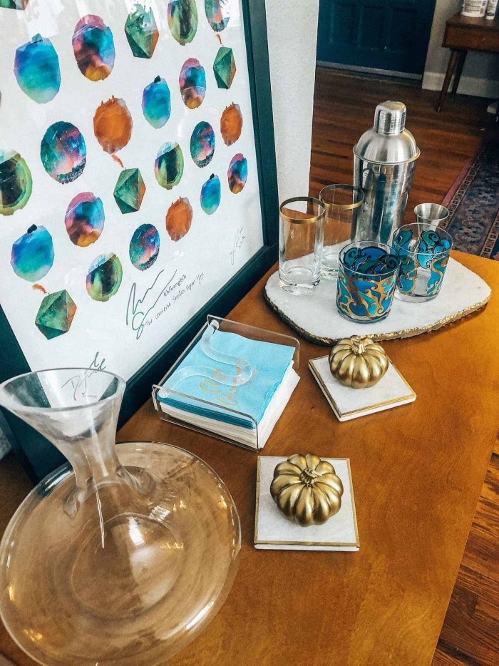 Bar cabinet with gold pumpkins